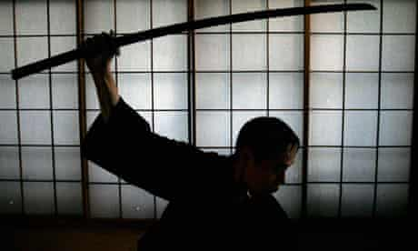 Japanese ancient martial arts master Yoshinori Kouno demonstrates his skills in Tokyo