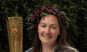 Sarah Milner Simonds with her Olympic torch
