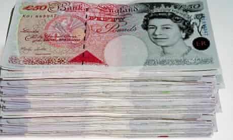 Pile of British bank notes.