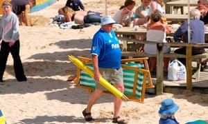 Man walking on Porthminster beach
