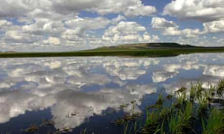 Waterlogged field reflecting the sky near Great Falls, Montana