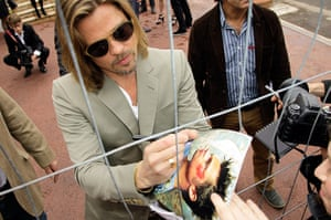 Cannes day 7: Brad Pitt signs autographs before the photocall for Killing Them Softly