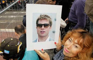 Cannes day 7: A fan holds a portrait of Brad Pitt for him to sign