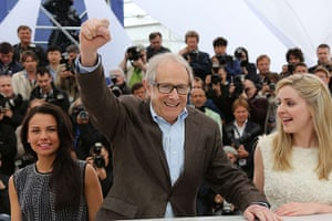 Cannes day 7: Ken Loach punches the air at the photocall for his film The Angel's Share