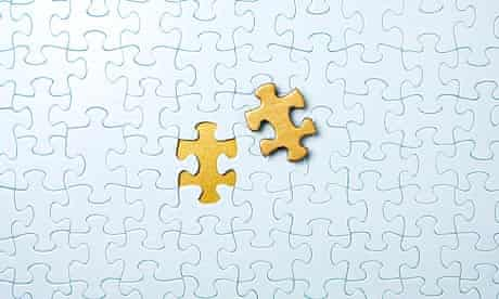 Jigsaw puzzle with gold piece