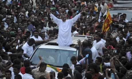 General Sarath Fonseka waves to supporters in Kandy