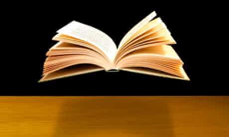 Open book floating above desk