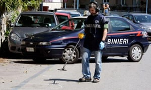 Italian police investigate the site where nuclear engineer Roberto Adinolfi was shot in Genoa.