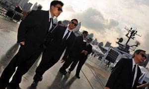 Actors dressed as Men in Black agents