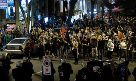 Protesters march in a demonstration against tuition fee hikes through the streets of Montreal