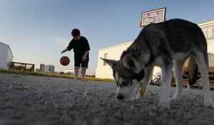 FTA: Joe Raedle: A boy plays basketball outside his family's FEMA trailer
