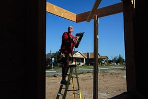FTA: Joe Raedle: A man helps build a Habitat for Humanity home where a home was knocked down