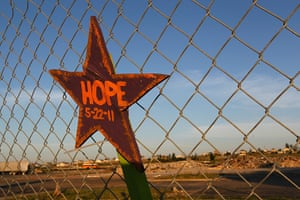 FTA: Joe Raedle: A sign reading Hope on a fence around the rubble of the Joplin High School