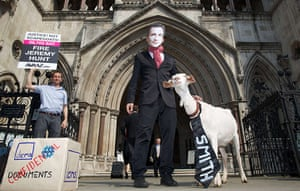Picture Desk Live: A demonstrator wears a mask depicting Jeremy Hunt