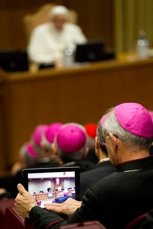 Picture Desk Live: A bishop uses his tablet to take pictures of Pope Benedict XVI