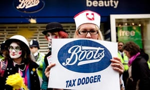 UK Uncut activists outside a Boots chemist during the March for the Alternative in 2011
