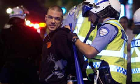 Police detain a protester in Montreal