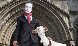 A demonstrator wears a Jeremy Hunt mask while holding a goat named Adam Smith