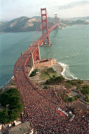 people on bridge: several hundred thousand jams the deck of the Golden Gate Bridge