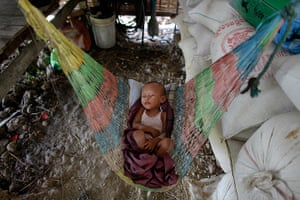 24 hours in pictures: A child sleeps in a hammock at a farm near Pyapon