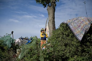 24 hours in pictures: A child looks in from a camp in Guatemala