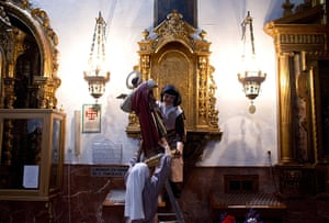 24 hours in pictures: Mexican cloister nuns hold a Saint Pancras image in Seville