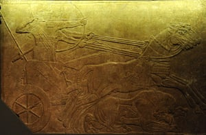 Horse: Assyrian wall relief showing a lion hunt