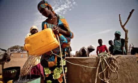A woman refilling her bucket from a well in Natriguel, in the south of Mauritania