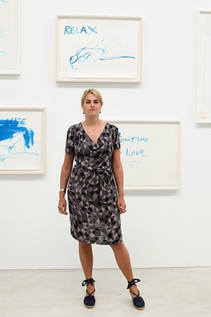 Tracey Emin exhibition: Tracey Emin poses for a picture in front of her artwork