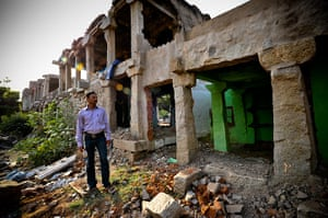 Hampi: P.Hussen stands outside the wreckage of his home in the Hampi bazaar