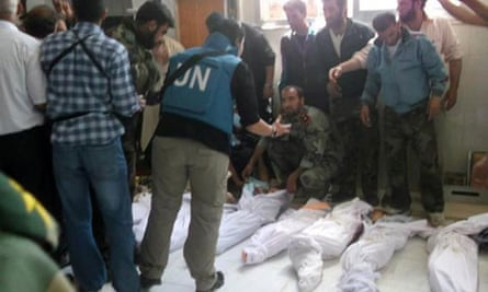 UN observers at a hospital morgue in the central Syrian town of Houla