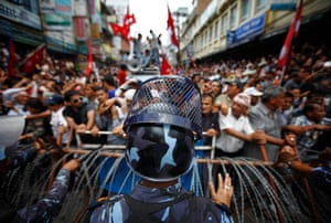 24 hours: Kathmandu, Nepal: A riot police officer stands in front of barricades