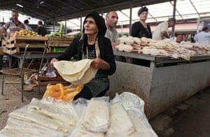24 hours: Baku, Azerbaijan: A vendor sells hand-made bread at the central market