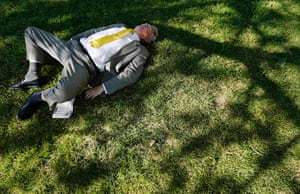 24 hours: Green Park, London: A man sleeps under a tree