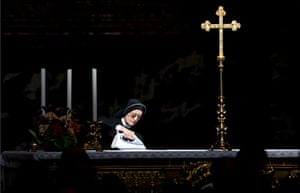 24 hours: The Vatican: A nun irons a secondary altar before the arrival of the Pope