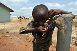 24 hours: Koidu, Sierra Leone: A boy drinks from a water tap