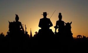 24 hours: Huelva, Spain: Pilgrims ride on horses near the shrine of El Rocio