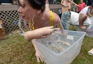 Redneck games: Katie Ashley competes in the 'Bobbing for Pigs' Feet' event