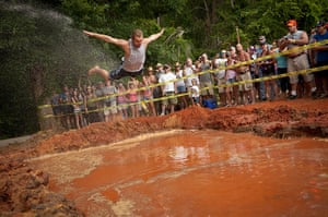 Redneck games: A competitor belly flops into a mud pit