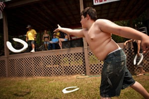Redneck games: A competitor throws a toilet seat