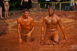 Redneck games: Competitors wade out of the mud pit