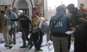 UN observers at a morgue holding victims of the Houla massacre