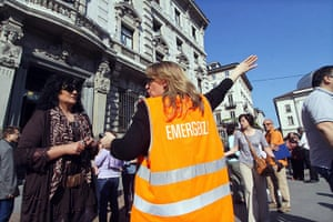 Italy earthquake: A volunteer helps people evacuate offices in central Milan