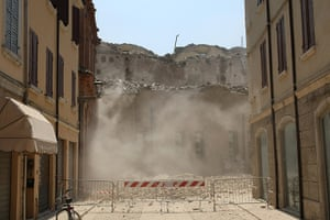 Italy earthquake: Smoke rises from a building which collapsed after a earthquake in Mirandola