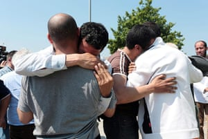 Italy earthquake: Factory workers grieve and console each other outside the Meta factory