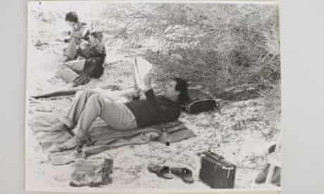 Gaddafi in the desert with friends