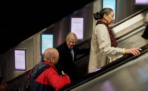 Local election: Boris Johnson talks to a commuter on an escalator after voting