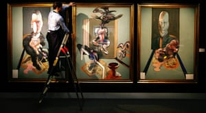 Top ten art auctions: A Sotheby's employee with Francis Bacon's Triptych, 1976