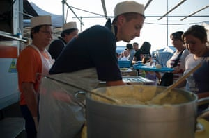 Italy earthquake: People queue for food at a displaced camp run by Protezione Civile