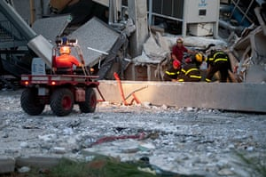 Italy earthquake: Rescue workers serach for a missing person at the Haemotronic plant
